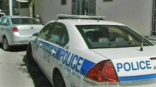 Montreal police raid an apartment in an attempt to arrest suspects in one of the three metro smoke bomb attacks.