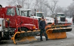 Hubbel French walks around his truck as he prepares to leave the the Virginia Department of Transportion, in Stephens City, Va. area headquarters to treat and plow area highways on Monday, Jan. 26, 2015. (AP / The Winchester Star, Ginger Perry)