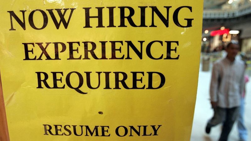 Customers walk past a help wanted sign at a Mississauga mall. (J.P. Moczulski / THE CANADIAN PRESS)