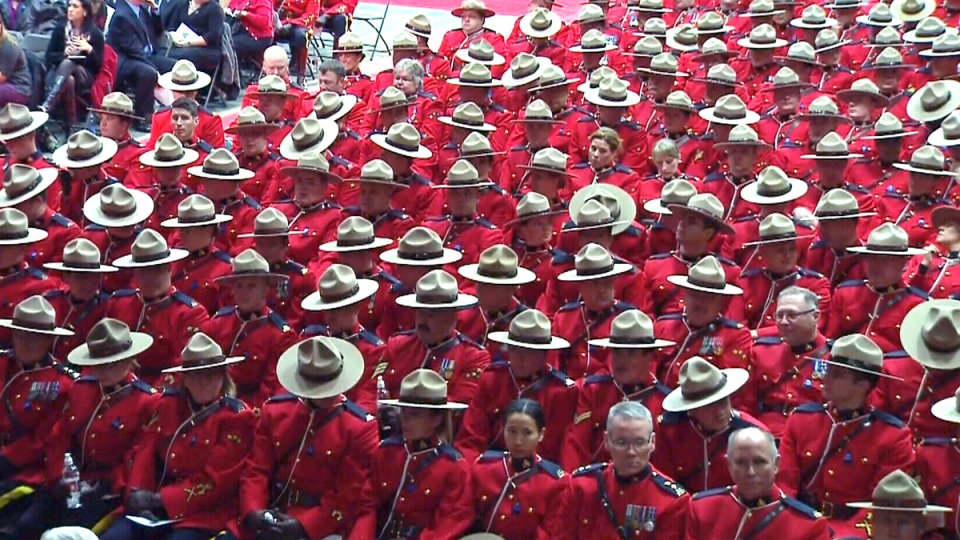RCMP officers await the beginning of the funeral for RCMP Const. David Wynn, in St. Albert, Alta., Monday, Jan. 26, 2015.