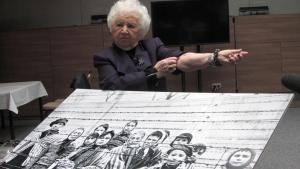 Miriam Friedman Ziegler, 79, of Thornhill, Ont., rolls up her sleeve to show her identification tattoo in Auschwitz, Poland on Monday, Jan. 26, 2015. (Adrienne Shulman / THE CANADIAN PRESS)