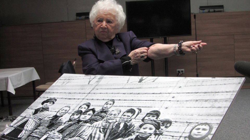 Miriam Friedman Ziegler, 79, of Thornhill, Ont., rolls up her sleeve to show her identification tattoo in Auschwitz, Poland on Monday, Jan. 26, 2015. (Adrienne Shulman / THE CANADIAN PRESS)