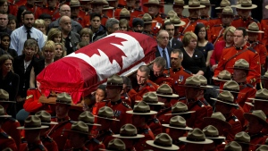 The casket of slain RCMP Const. David Wynn is carried into funeral in St. Albert Alta., on Monday, Jan. 26, 2015. (Jason Franson / THE CANADIAN PRESS)