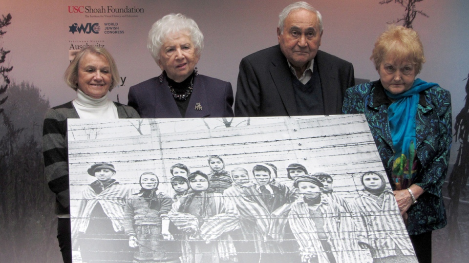 Miriam Friedman Ziegler, 79, of Thornhill, Ont., (second from left) poses for a group photo with other survivors in Auschwitz, Poland on Monday, Jan. 26, 2015. (Adrienne Shulman / THE CANADIAN PRESS)