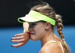 Eugenie Bouchard of Canada wipes the sweat from the face as she plays Maria Sharapova of Russia during their quarterfinal match at the Australian Open tennis championship in Melbourne, Australia, Tuesday, Jan. 27, 2015. (AP / Rob Griffith)
