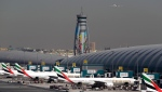In this Thursday, May 8, 2014, file photo, Emirates passenger planes are parked at their gates at Dubai Airport in United Arab Emirates. (AP Photo/Kamran Jebreili, File)