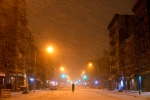 A person stands in the middle of snow-covered Avenue A in the East Village neighbourhood of New York. (AP / Patrick Sison)