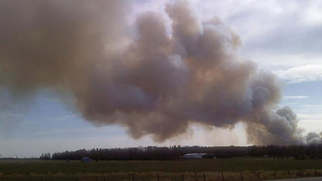 A wildfire burning near Drayton Valley has RCMP advising residents in the area to evacuate. May 12.