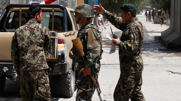Afghan National Army soldiers secure the gate of the military hospital after Arsala Rahmani, a former Taliban official turned Afghan peace negotiator, was killed by an unknown attacker in western Kabul