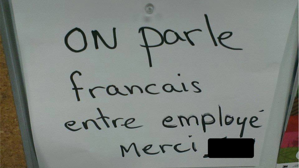 Note to employee to speak French at work