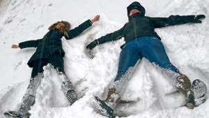 Kids take advantage of the snowstorm in New York, Tuesday Jan. 27, 2015. (AP / Jennifer Peltz)
