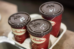 Cups of coffee sit on a counter in a Tim Hortons outlet in Oakville, Ont., on Monday, Sept. 16, 2013. (Chris Young / THE CANADIAN PRESS)