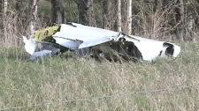 Debris is shown at the scene of a plane crash near St. Brieux, Sask. on Saturday, May 12, 2012.