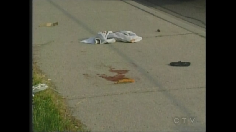 A bloody t-shirt is seen in the area where 19-year-old Jared McKnight was stabbed on Adelaide St. in London, Ont. on May 31, 2012.