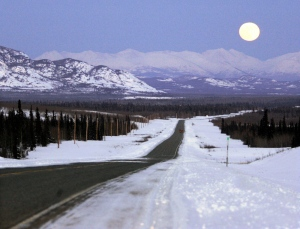 In this file photo the moon rises over mountains along the Alaska Highway heading west to Whitehorse in the Yukon Sunday March 4, 2007. (Chuck Stoody / THE CANADIAN PRESS)