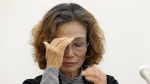 Junko Ishido, mother of Japanese hostage Kenji Goto held by Islamic State group, reacts during a press conference in Tokyo, Wednesday, Jan. 28, 2015. (AP / Shizuo Kambayashi)