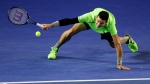 Milos Raonic reaches out for a shot to Novak Djokovic during their quarterfinal match at the Australian Open tennis championship in Melbourne, Australia, Wed., Jan. 28, 2015. (AP / Rob Griffith)