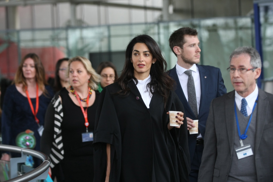 Amal Clooney, centre, a member of a legal team representing Armenia, enjoys a coffee during a break at the European Court of Human rights in Strasbourg, eastern France, Wednesday, Jan. 28, 2015. (AP / Christian Lutz)