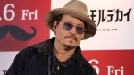 U.S. actor Johnny Depp poses for photographers during a photo session prior to a press conference to promote his latest film 'Mortdecai' in Tokyo, Wednesday, Jan. 28, 2015. (AP / Eugene Hoshiko)