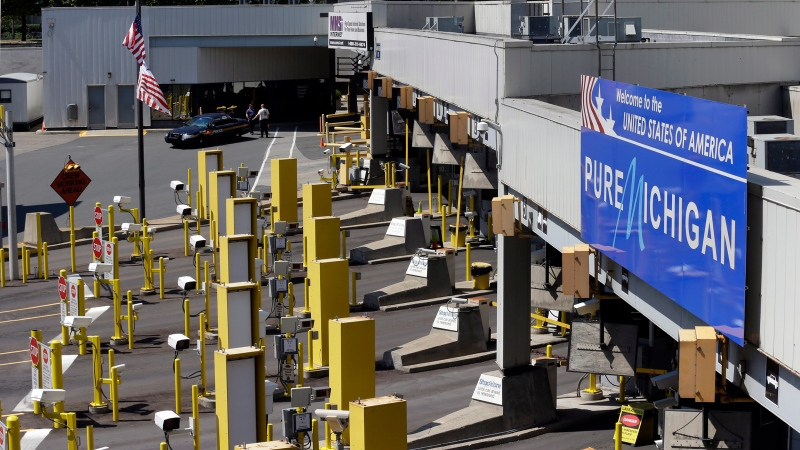 Lanes entering the United States at the Detroit Windsor Tunnel are shown in this Thursday, July 12, 2012 photo. (AP Photo/Paul Sancya)