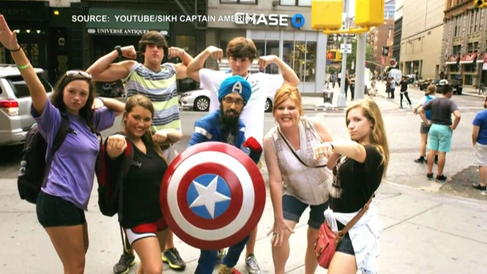 Vishavjit Singh poses with tourists as Sikh Captain America in the short documentary 'Red, White and Beard.' (YouTube / Sikh Captain America)