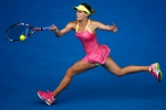 Eugenie Bouchard of Canada reaches out for a shot to Maria Sharapova of Russia during their quarterfinal match at the Australian Open tennis championship in Melbourne, Australia, Tuesday, Jan. 27, 2015. (AP Photo/Vincent Thian)