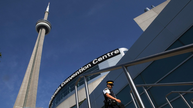 An RCMP officer patrols outside the Metro Toronto Convention Centre on Friday June 25, 2010. THE CANADIAN PRESS/Frank Gunn