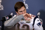 New England Patriots quarterback Tom Brady listens to a question during a news conference in Chandler, Ariz., on Wednesday, Jan. 28, 2015. (AP / Mark Humphrey)
