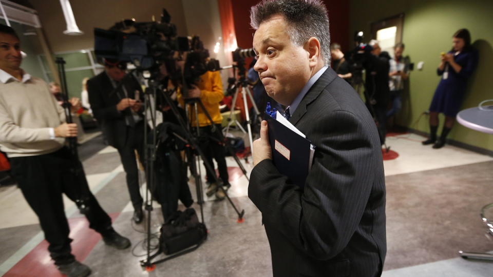 Geoff Patton, acting director of the Water and Waste Department, updates media at a press conference, in Winnipeg, Wed., Jan. 28, 2015. (John Woods / THE CANADIAN PRESS)