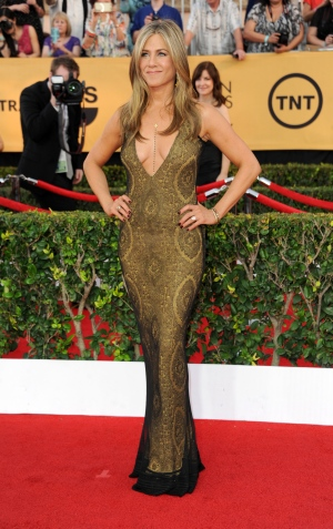 Jennifer Aniston arrives at the 21st annual Screen Actors Guild Awards at the Shrine Auditorium in Los Angeles. Calif. on Sunday, Jan. 25, 2015, in Los Angeles. (Richard Shotwell / Invision)