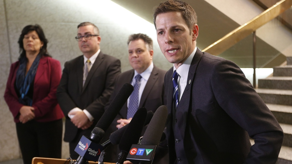 Winnipeg Mayor Brian Bowman updates media at a press conference as Geoff Patton, Acting Director, Winnipeg Water and Waste Department, Michael Jack, Acting Chief Administrative Officer for the City of Winnipeg and Diane Sacher, Director of Water and Waste listen in Wednesday, Jan. 28. (John Woods / THE CANADIAN PRESS)