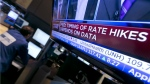 A television screen on the floor of the New York Stock Exchange shows the decision of the Federal Reserve, Wed., Jan. 28, 2015. (AP / Richard Drew)