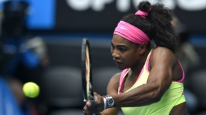 Serena Williams makes a backhand return to Madison Keys during their semifinal match at the Australian Open tennis championship in Melbourne, Australia, Thu., Jan. 29, 2015. (AP / Andy Brownbill)