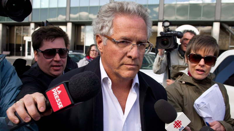 In this file photo, Quebec construction magnate Tony Accurso leaves the Quebec Provincial Police headquarters after being arrested for charges of fraud in Montreal, Tuesday, April 17, 2012. (The Canadian Press / Paul Chiasson)