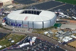In this aerial photo, the playing field for the NFL Super Bowl XLIX football game is rolled into the University of Phoenix Stadium, Wednesday, Jan. 28, 2015, in Glendale, Ariz. (AP Photo/Ross D. Franklin)