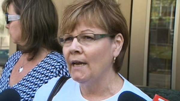 Carol DeDelley, the mother of Tim McLean, is seen speaking to reporters outside a court in Winnipeg.