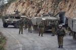Israeli soldiers secure the Israel-Lebanon border, Wednesday, Jan. 28, 2015. (AP Photo/Ariel Schalit)