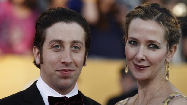 Simon Helberg, left, and Jocelyn Towne arrive at the 18th Annual Screen Actors Guild Awards on Sunday Jan. 29, 2012 in Los Angeles. (AP Photo/Matt Sayles)
