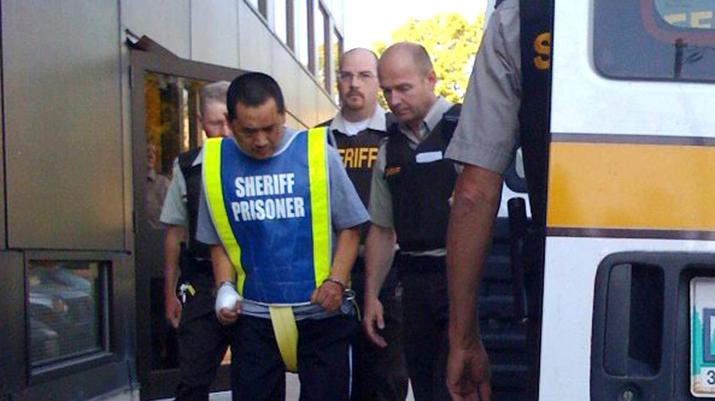 Vince Weiguang Li is led into the Manitoba Provicial Court in Portage La Prairie, Man. on Friday Aug. 1, 2008. (Winnipeg Free Press - James Turner)