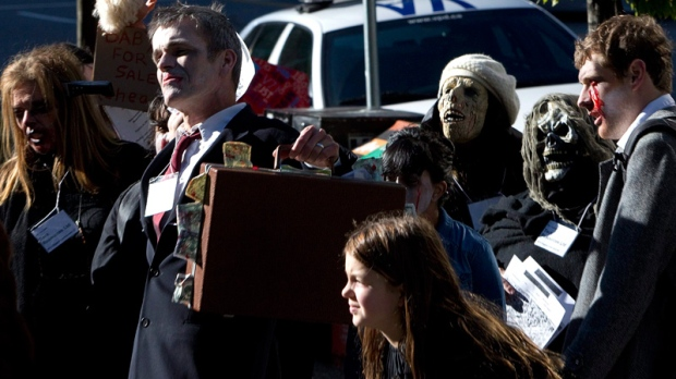 Members of the Occupy Vancouver movement take part in a Zombie Walk throughout downtown Vancouver, B.C., Monday, Oct. 31, 2011. (Jonathan Hayward / THE CANADIAN PRESS)