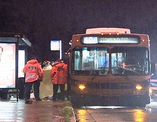 Police examine a bus that accidentally dragged a B.C. man six kilometers on Friday night.