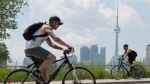 Cyclists ride in Toronto on Wednesday, June 26, 2012. (Frank Gunn / THE CANADIAN PRESS)