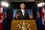 Alberta Premier Jim Prentice announces a 5 per cent wage cut to all cabinet ministers during a press conference in Edmonton, Alta., on Thursday, January 29, 2015. (THE CANADIAN PRESS/Jason Franson)