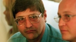 In this Sept. 14, 1998 file photo, Eugene de Kock, the head of a covert police unit that tortured and killed dozens of people, attends an amnesty hearing of the Truth and Reconciliation Commission (TRC) in Pretoria, South Africa. He's been granted parole after two decades in jail. (AP / Denis Farrell, File)