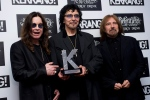 From left, Ozzy Osbourne, Tony Iommi and Geezer Butler of Black Sabbath with their Inspiration Award at the Kerrang Awards 2012, at a central London venue. Thursday, June 7, 2012. (AP Photo/Jonathan Short)