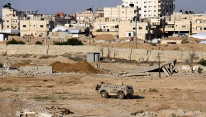 FILE - In this Nov. 6, 2014 file photo, an Egyptian army armored vehicle stands on the on the Egyptian side of border town of Rafah, north Sinai, Egypt.(AP Photo/Ahmed Abd El Latif, El Shorouk Newspaper, File)