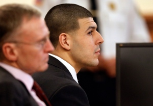 Former New England Patriots football player Aaron Hernandez, right, listens during his murder trial as defense attorney Charles Rankin, left, looks on, Thursday, Jan. 29, 2015, in Fall River, Mass. Hernandez is charged with killing semiprofessional football player Odin Lloyd, 27, in June 2013. (AP/Steven Senne, Pool)