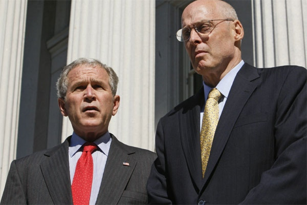 President Bush, left, speaks with reporters as he stands on the steps of the Treasury Department with Treasury Secretary Henry Paulson after the House passed the $700 billion financial bailout bill at the White House in Washington, Friday, Oct. 3, 2008. (AP Photo/Charles Dharapak)