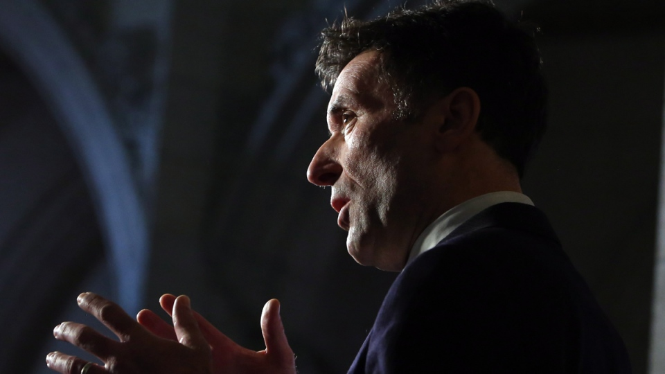 In this file photo, then-NDP Foreign Affairs critic Paul Dewar talks with reporters as he reacts to the Harper government's new anti-terror bill, on Parliament Hill, in Ottawa on Friday, Jan. 30, 2015. (Fred Chartrand / THE CANADIAN PRESS)