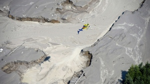 An aerial view shows the damage caused by a tailings pond breach near the town of Likely, B.C., on Aug., 5, 2014. (Jonathan Hayward / THE CANADIAN PRESS)